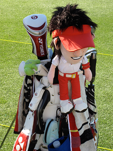 needs a strong caddie to carry his bag and all its accessories.