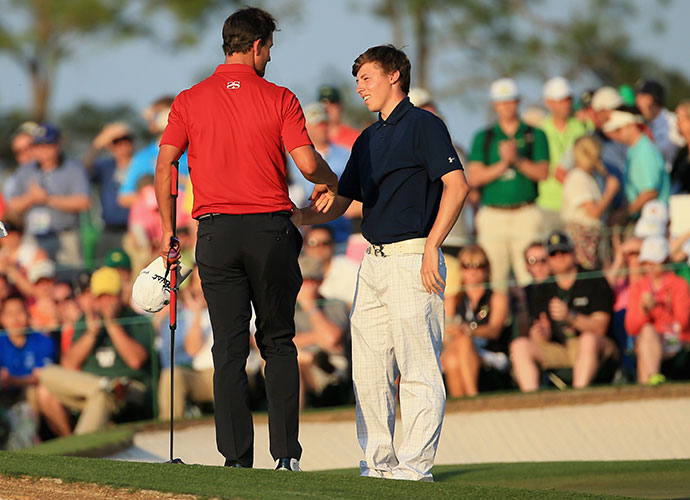 Adam Scott shakes hands with amateur Matthew Fitzpatrick of England on the 18th green.