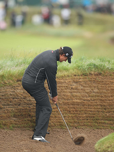 The pot bunkers in the fairways at Carnoustie make reaching the greens very difficult. Adam Scott learned that lesson the hard way. The world's No. 5 player shot a two-over 73 on Thursday.