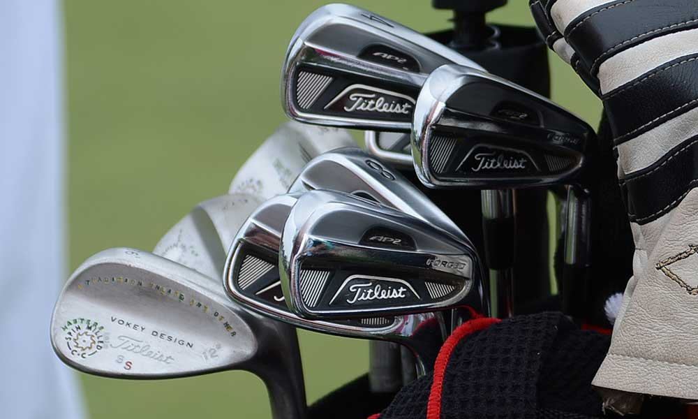 "On the back of Scott Stallings' Vokey Design Spin Milled wedge, Titleist stamped in tiny letters, ""A Tradition Unlike Any Other."" He's also playing Titleist's AP2 712 irons."