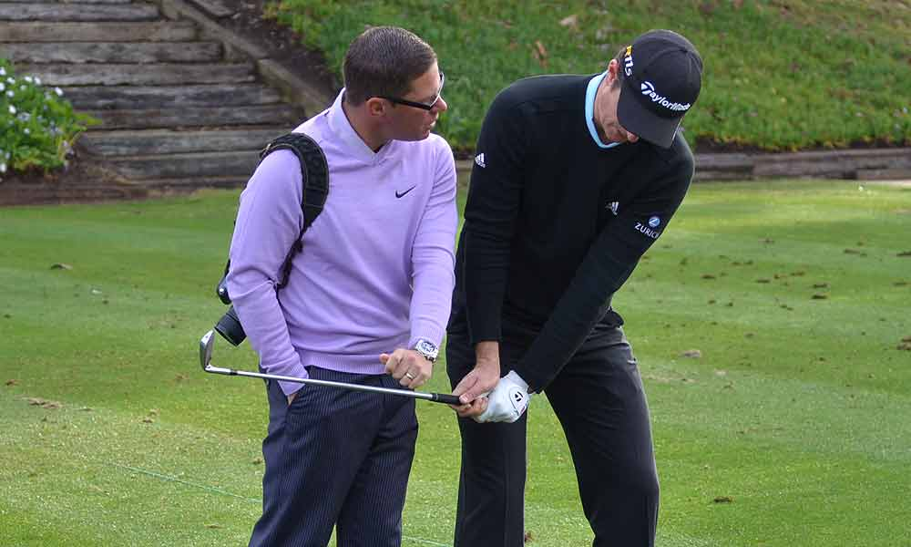 Sean Foley, who is not in Abu Dhabi with Tiger Woods this week, worked with Justin Rose on the range Tuesday morning.