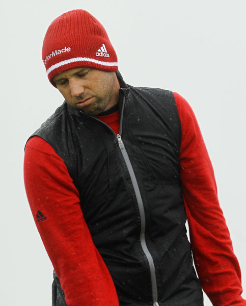 Conditions at times were very tough, with strong winds and horizontal rain. Sergio Garcia came well prepared, with mittens and a wool hat, although for a moment he looked as though he wished to be elsewhere.