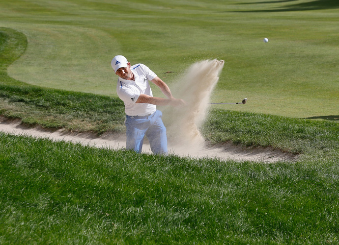 Garcia chips out of the bunker on the 15th hole.