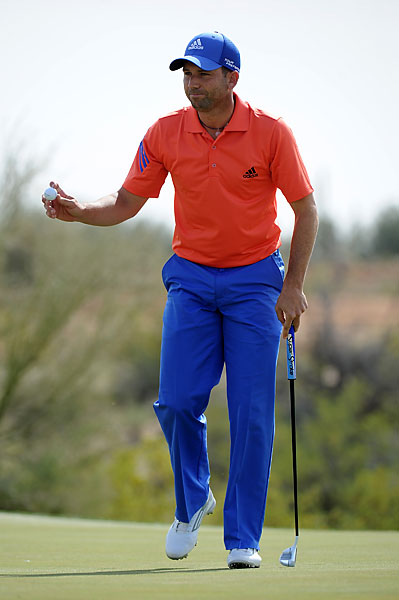 Sergio Garcia acknowledges the gallery during his match against Rickie Fowler.
