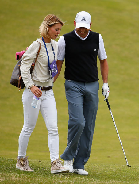 Sergio Garcia walks with girlfriend Katharina Boehm during his Wednesday practice round.