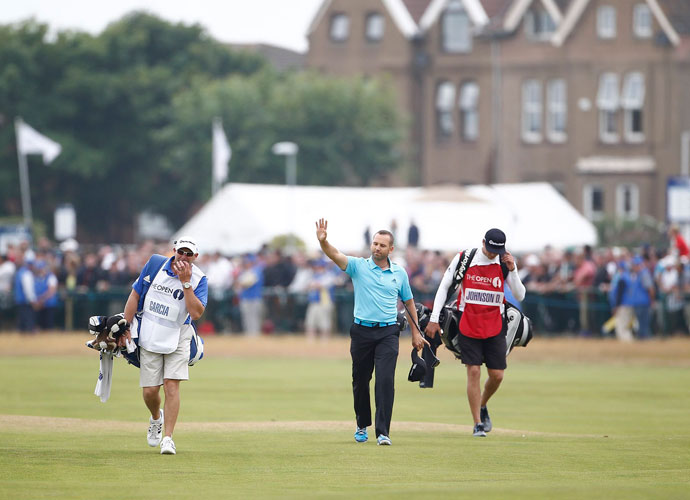Sergio Garcia acknowledges the cheers from the crowd as he walks up the 18th fairway. He finished tied for fifth the last time the Open was played at Hoylake.