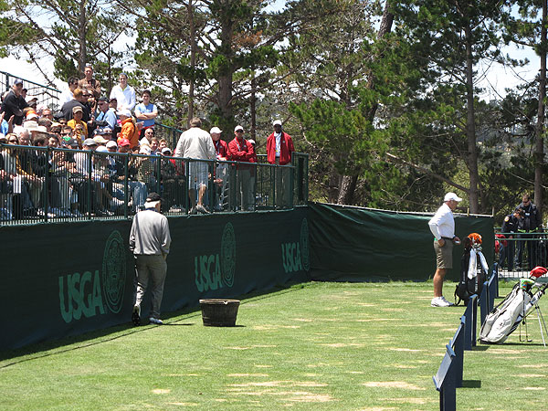 walked the entire length of the driving range at Pebble Beach before putting Tiger Woods's bag at the end. When he did, the fans behind the bag cheered, knowing they had chosen the perfect spot.