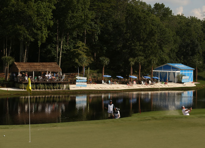 Andrew Svoboda plays his third shot out of the bunker on the 15th hole near a special Wyndham waterfront attraction.