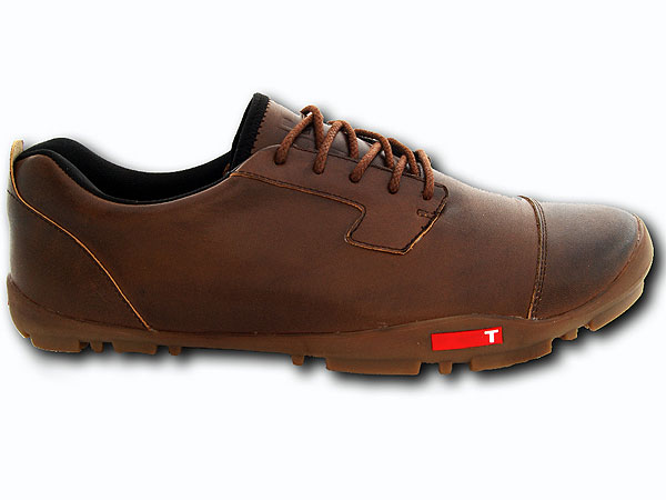Combining the spikeless idea with the barefoot or natural-motion concept, the TRUE linkswear golf shoe features thin soles, traction treads, and 360-degree waterproofing, as in the Stealth model shown here ($199). TRUE linkswear shoes, worn by Ryan Moore on the Tour, they have their own unique look.