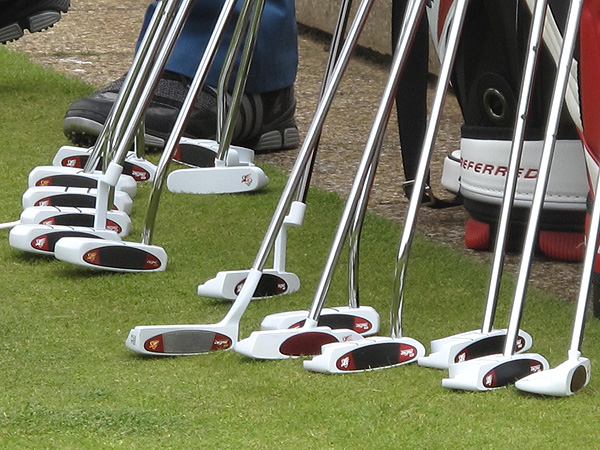 Pros who wanted to try one of TaylorMade's white Ghost putters had plenty of options on the practice green.