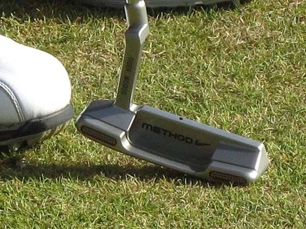 Tiger switches putters                       Tiger Woods turned a lot of heads at St. Andrews in July when he practiced for the British Open using a Nike Method 001 putter. Woods said the putter helped him get the ball rolling more quickly on the slow greens, and he used it for three rounds before going back to his trusty Scotty Cameron.                                              Playing in the Australian Masters, Woods once again used a Nike Method putter, this time a mallet-shaped 003 model. It stayed in his bag during the flight back to the United States, and Woods used it at the Chevron World Challenge, where he lost in a playoff to Graeme McDowell.