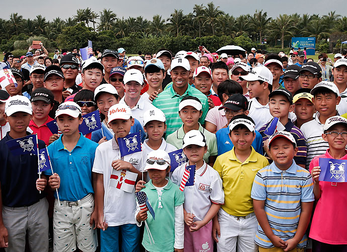 Golf's popularity in China -- indeed, throughout Asia -- is growing rapidly. Here, Rory McIlroy and Tiger put in some face time with the fans.