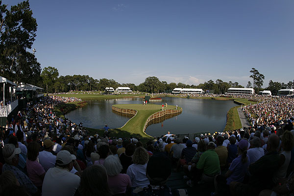 """Woods putting on the famous 17th green at TPC Sawgrass during the second round of the Players Championship. If there was ever a golf location that could be called a stage, this is it. I have been photographing this event for many years, but a newly erected grandstand gave me a different angle this year."""