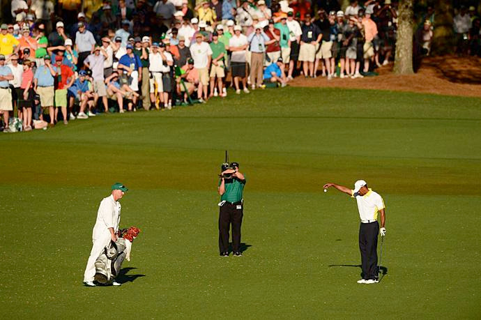 "Woods entered Augusta with momentum from three-early season victories, but it came to a halt on the 15th hole in the second round. Woods' approach shot clanked off the flagstick and into the pond. His ensuing drop was deemed to be illegal after the round was over, but rather than disqualify Woods for signing an incorrect scorecard Augusta officials hit him with a two-shot penalty. Woods played on, and ""dropgate"" overshadowed his performance during the weekend -- and beyond. It was arguably the biggest moment of the 2013 golf season. Woods closed with two rounds of 70 to tie for fourth place."