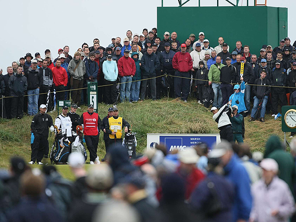 When Tiger plays in the United States the crowds follow his every move. As evidenced here on the fifth tee, the same thing happens in Scotland.