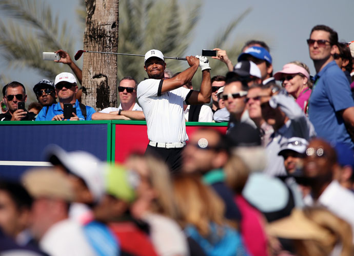 Tiger Woods hits a tee shot in the Champions Challenge.
