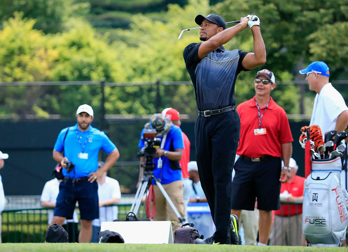 2014 | Comeback                         Tiger returns this week at the Quicken Loans National, where he hit balls in preparation for his first competitive golf since March 9.