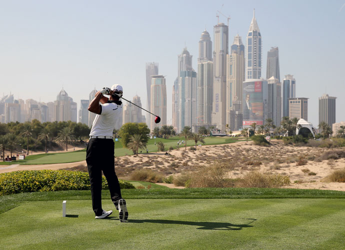 Tiger Woods tees off on the eighth hole Tuesday during the Champions Challenge at the Omega Dubai Desert Classic in the United Arab Emirates. The event was for the 25 former winners of the Desert Classic.