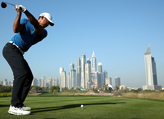 Tiger Woods hits his tee shot on the eighth hole during the pro-am portion of the Dubai Desert Classic on Wednesday. Woods is a two-time victor in the tournament (2006, 2008).