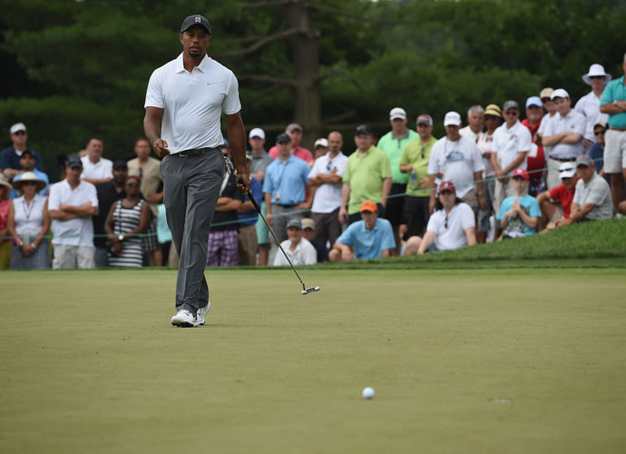 "Tiger Woods looks at his missed putt on the first hole of his second round. ""I made a ton of simple little mistakes,"" he said after his round."