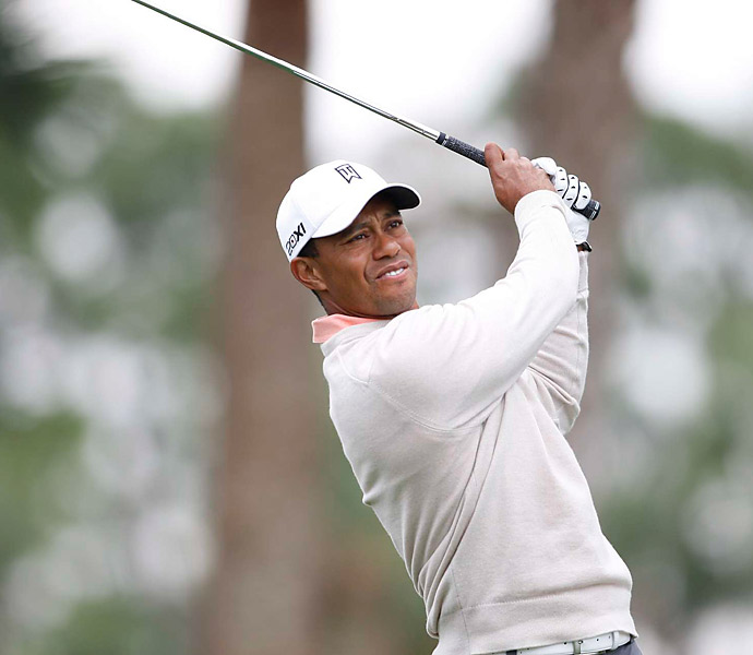 Tiger Woods opened with an even-par 70 Thursday morning at PGA National.