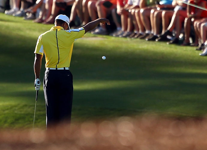 Tiger Woods takes a drop on the 15th hole during the 2013 Masters. He was later assessed a two-stroke penalty for playing an incorrect drop. He finished tied for fourth, four back of eventual champion Adam Scott and Angel Cabrera.