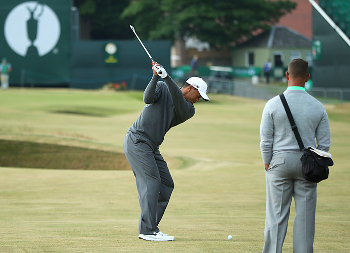 Woods worked with his swing instructor Sean Foley during the round.