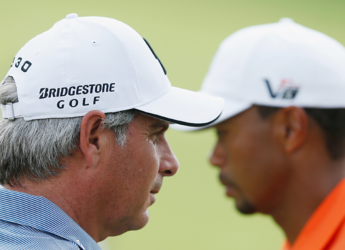 Woods played with Fred Couples.