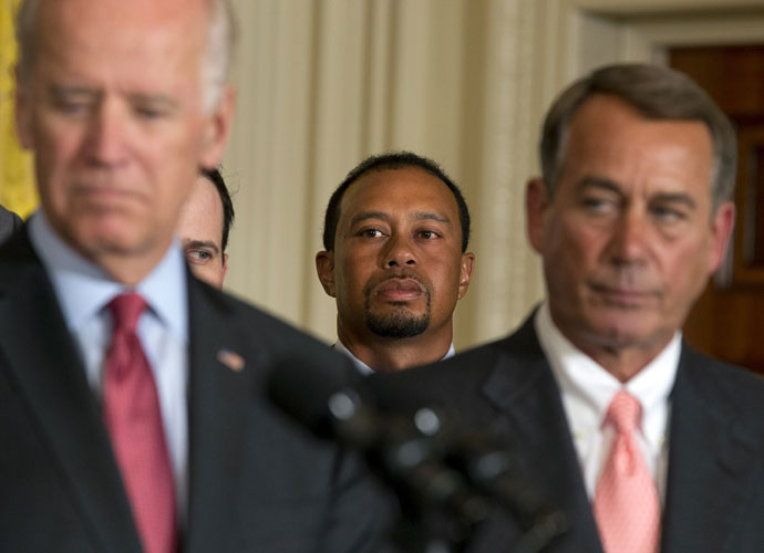 Tiger watches behind Vice President Joe Biden, left, and House Speaker John Boehner, R-Ohio, as President Barack Obama speaks during the ceremony. Boehner carries a single-digit handicap and is known as one of the top golfers on Capital Hill.