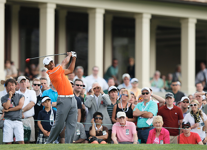 Woods had five birdies and four bogeys on day one.