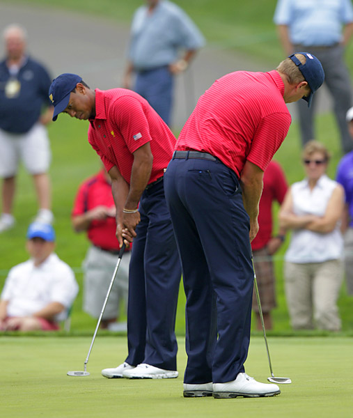 Woods and frequent playing partner Steve Stricker helped each other out on the practice putting green.