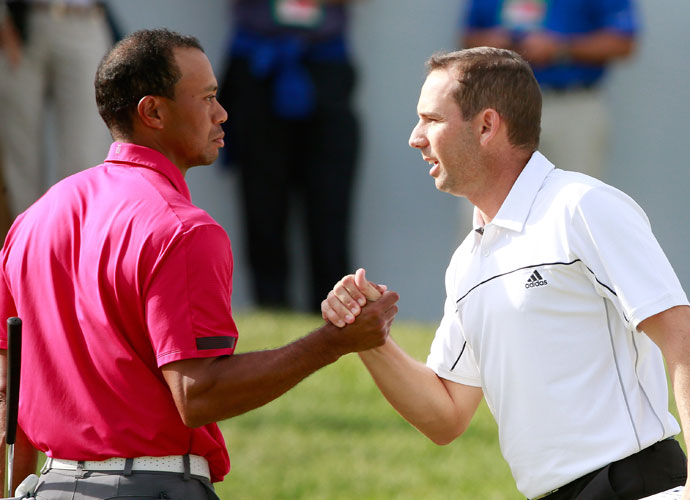 Tiger's Glare                         Brrrrrrrr. Tiger doesn't forget. That's frequent sparring partner Sergio Garcia on the receiving end of a withering stare during the 2013 BMW Championship. The meeting came a few months after Tiger and Sergio's dust up at the Players Championship, which was followed by a racially-tinged insult from Sergio, for which he later apologized.
