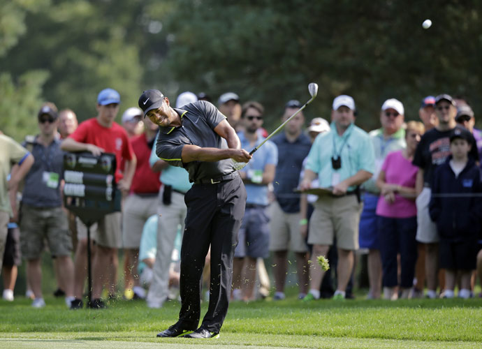 Tiger Woods hits his approach shot to the 11th. PGA Championship pairings were announced during the second round and Tiger will play the first two days with Phil Mickelson and Padraig Harrington.
