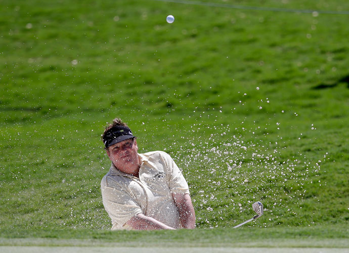 Tim Herron hits out of a bunker onto the 17th green during the first round of the HP Byron Nelson Championship. Herron shot 66 in the second round and was among the group at -6, two shots back of leader Brendon Todd.