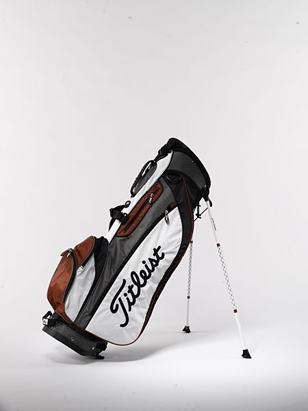 Titleist Lightweight Stand ($165): A polyurethane handle is integrated into the top of the bag for easy lifting, and a cart-friendly bottom (it fits securely in both motorized and pull carts) makes it a solid choice for walking or riding. Also included is a towel ring, umbrella cord, matching zippered rain hood, Velcro leg-lock strap, and mesh-covered, foam-filled hip pad for additional comfort.