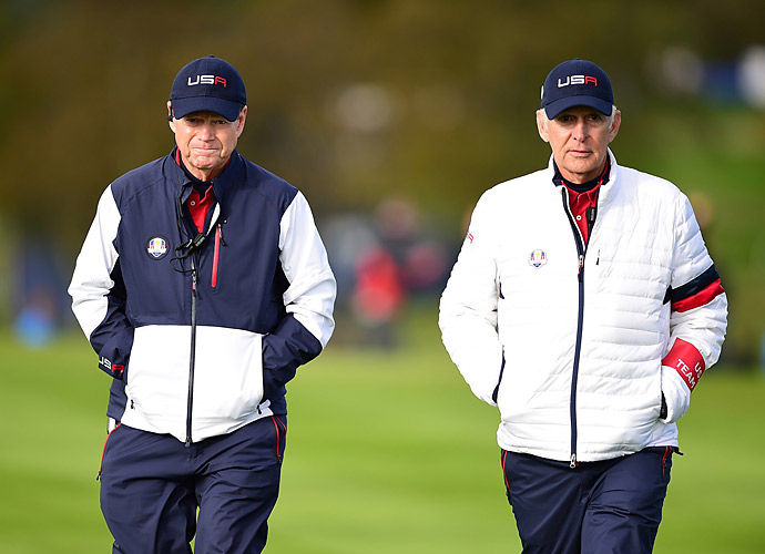 U.S. captain Tom Watson and vice captain Andy North walk the course on Saturday.