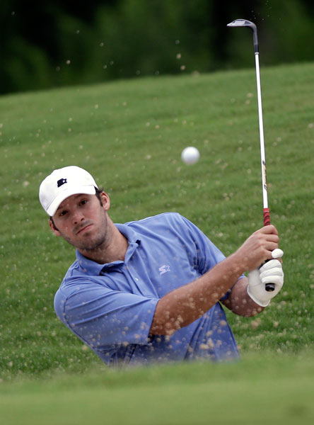 Dallas Cowboys quarterback Tony Romo hits out of a bunker during a U.S. Open sectional qualifying round in 2010 in Texas. Romo, who didn't make the field, has a +.3 handicap at the Dallas National Golf Club. You can get your own USGA-recognized handicap, track greens in regulation, putts per round and more at Golf.com's handicap tracker.