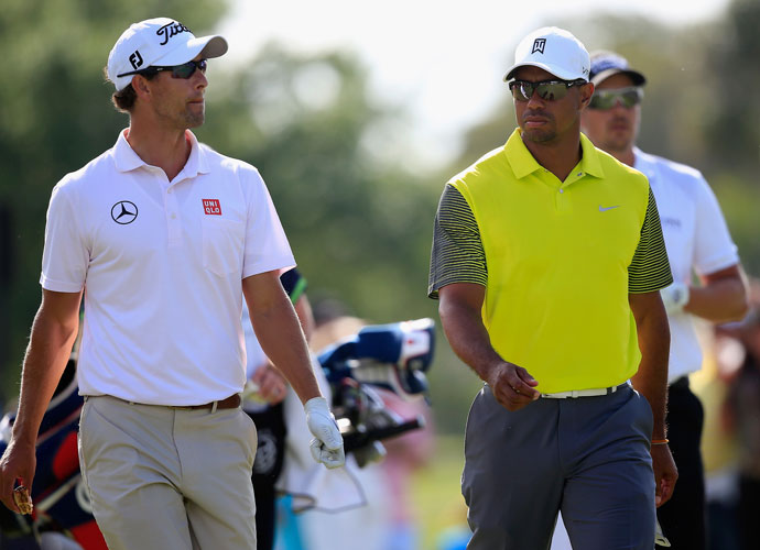 The world's top three players, Adam Scott, Tiger Woods and Henrik Stenson walk off the fifth tee during the second round of the WGC-Cadillac Championship.