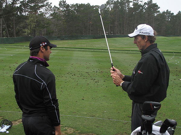 (left), the 2008 Masters champion, talked about his grip at length with swing guru David Leadbetter during his practice session.