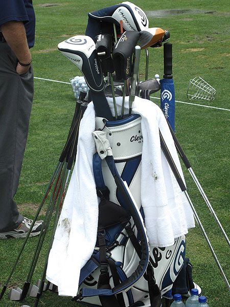 Vijay Singh wasn't phased by the tough conditions on the range Monday. The Fijian brought plenty of clubs to hit, including a weighted driver he uses to warm up.