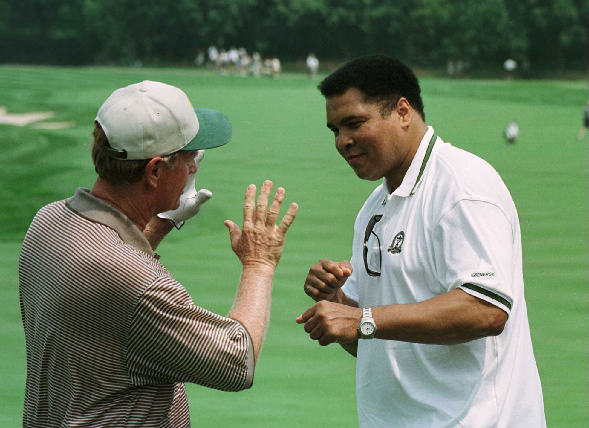 """1996                      With Kentucky hosting its first golf major since the 1952 PGA, the presence of Louisville legend Muhammad Ali does not go unnoticed. On tournament eve, a friendly shadow-boxing match breaks out between Ali and Jack Nicklaus, two titans with claims to the title """"Greatest of All Time."""""""