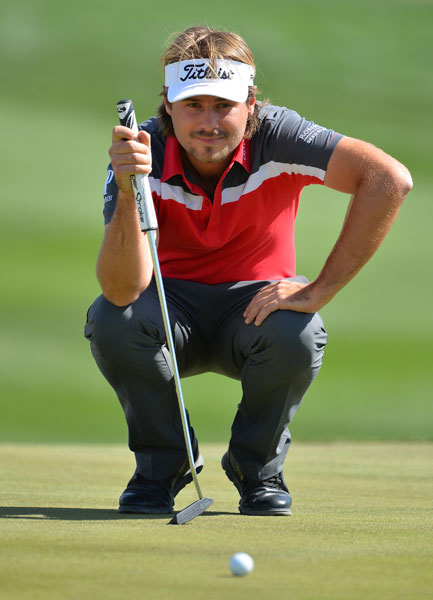Victor Dubuisson gets a read on a putt in his victory over Graeme McDowell.