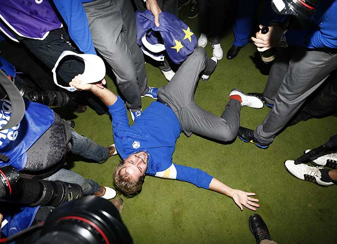 France's Victor Dubuisson is literally knocked off his feet while celebrating Europe's win on the 18th hole at Gleneagles.