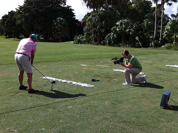In addition to putting, afternoons at ClubTest include trying clubs on the range. Here, SI videographer Billy Tucker filmed a tester hard at work.