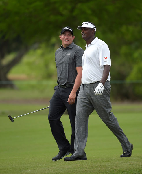 Scott Stallings and Vijay Singh head to the seventh green after eluding the baby gator.