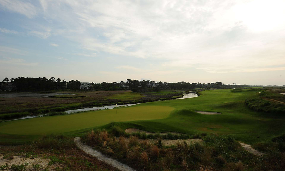 Hole 13, 497 yards, Par 4                       The thirteenth is classic risk-reward, as golfers must decide how much of the diagonal canal to carry from the tee. Whatever they choose, water comes into play on the second shot, into this narrow green.
