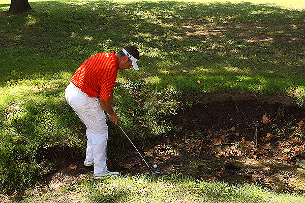 England's Lee Westwood had to play out of a dried creek bed Saturday on the 4th hole. Remarkably, he went on to make par on the hole, but he scored only one birdie against  six bogeys on the day to shoot 75.