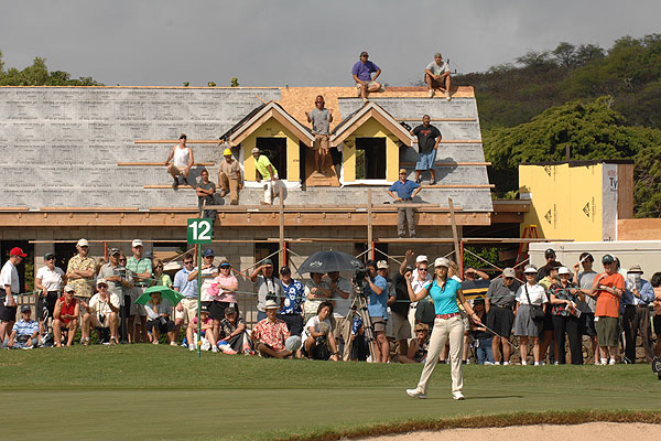 """Michelle Wie had a terrible year, but she still draws a crowd. The gallery at the Sony Open included a crew of construction workers."""