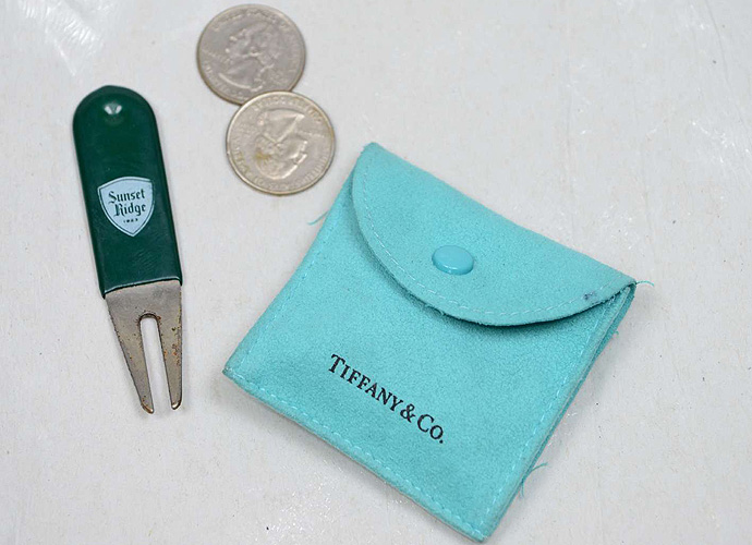 Nothing says you've made it like keeping your divot repair tool and some ball markers in a Tiffany bag.