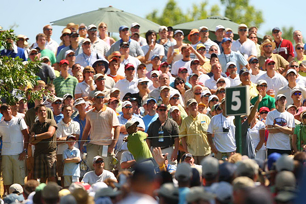 All eyes were on tournament leader Tiger Woods as he teed off on the par-5 5th hole Saturday.